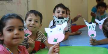 Young children participate in an activity as part of Save the Children's early childhood care and development programming.