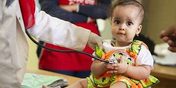 A young girl gets a check up in Egypt.
