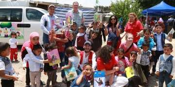 A team in Lebanon are part of a mobile library run out of a van.