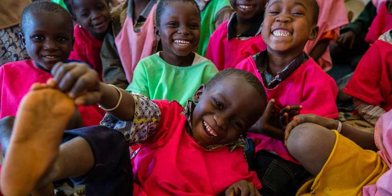 A 6-year-old laughs as he plays with friends within an Early Childhood Care and Development program in Mali. Photo credit: Victoria Zegler/Save the Children 2018.