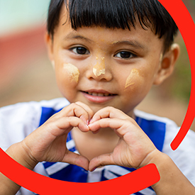 Official Usa Website  Save The Children A Yearold Child Makes The Heart Symbol With Her Hands The