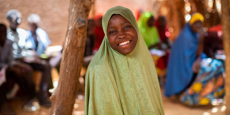 "14-year-old Zakiya stands inside of her ""second chance"" school, designed at the community level so that children who wish to pursue their education after primary school have the resources to do so on Monday, April 15th in Maradi, Niger.."