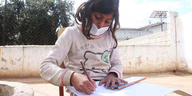 Karma, 9, live in a camp in northern Idlib in Syria where they attends a school supported by Save the Children's partner. Because of the coronavirus pandemic, our partners have had to adapt their programming and now do virtual classes to support remote learning. *Name changed for protection
