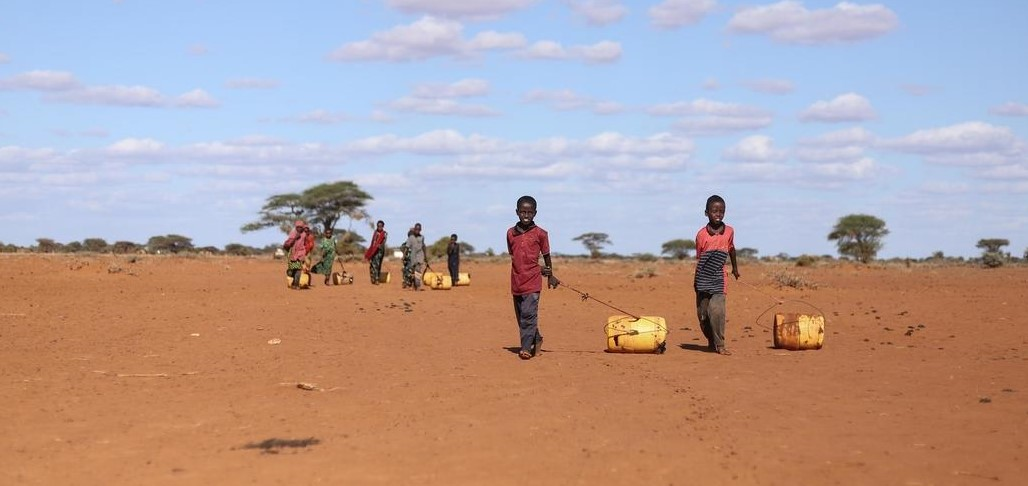 Children in Kenya head to a watering point to collect what they can. In Kenya, drought has devastated millions of people, including children.  The desperate search for food, water or an income has put millions of children's lives and futures at risk as they must travel far distances in search of water, often times risking injury, violence or worse. Photo credit: Mark Njoroge / Save the Children, October 2019.