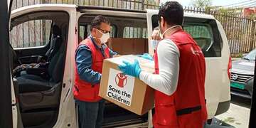 A Save the Children staff member delivers kits door to door in Beirut.