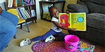 A student reads a book at her South Carolina home
