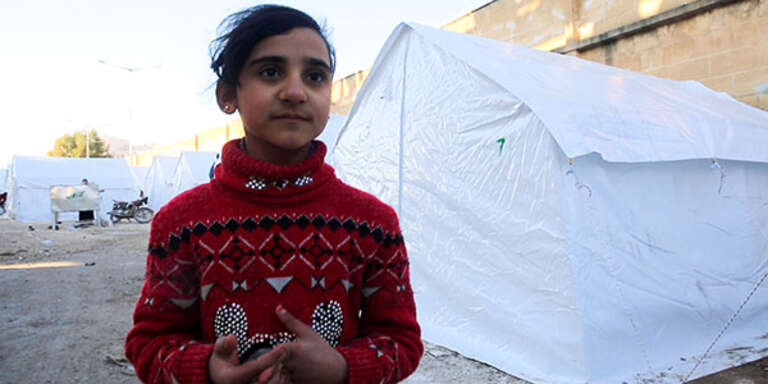 Hayat*, 10, fled Ma'arat Nu'man with her family and is now sheltering in a former playground in Idlib, NW Syria.