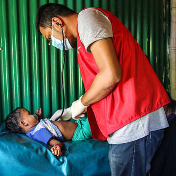 Runa* (3) is assessed at Save the Children's health clinic in Cox's Bazar, Bangladesh