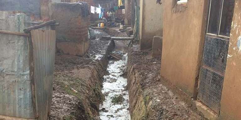 A drainage channel used for washing clothes is also where members of the community often have to dispose their waste.
