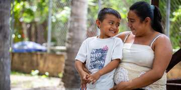 4-year-old Daniel, left, stands next to his pregnant mother Karla, 22, outside of their commuities local health post following a pregnancy club meeting on Tuesday, July 10, 2018 in the La Paz district of El Salvador.