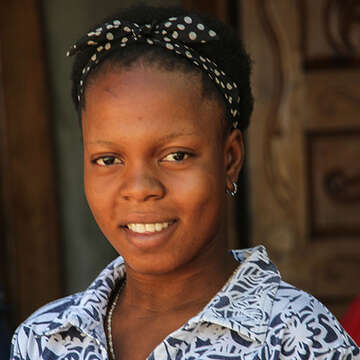 A portrait of Julienne, a previously sponsored child, now is a nurse in Dessalines Haiti.