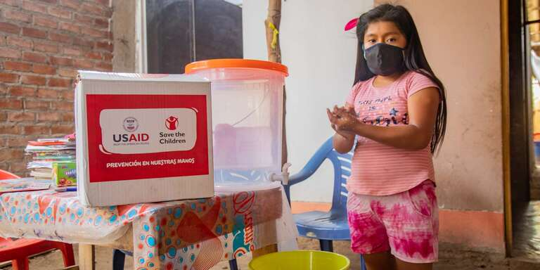In Peru, Ariana practices handwashing and hygiene with Save the Children and USAID support.