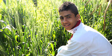 Ahmed working in his family's farm in Egypt.