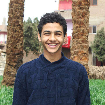 A portrait of Ahmed smiling in Abnoub, Egypt.