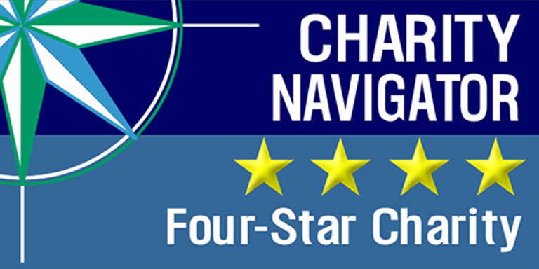 Charity Navigator's logo for a four-star charity rating includes four gold stars against a blue background.