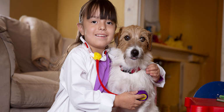 A little girl wearing a doctor's costume – a brightly colored plastic stethoscope and white lab coat – listens to the heartbeat of a dog. Sophia (her name changed for protection) is a child in one of our early education programs in rural California. She dreams of becoming a veterinarian one day, and just might, thanks to donors like you. Photo credit: Tamar Levine / Save the Children, December 2018.