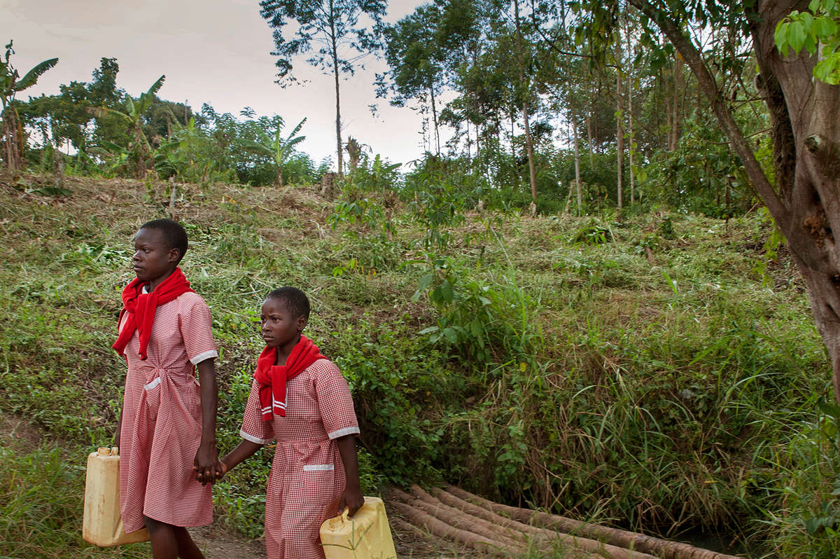 Because of the work of Save the Children, girls like Robina and Charity, ages 9 and 12, can safely fetch the family water – so they can get back to learning in Uganda. Photo credit: Save the Children/Rick D'Elia 2017.
