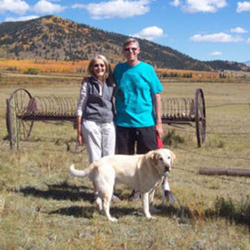 Christine and Duncan Orr pose for a photograph. Christine and Duncan Orr's decision to include Save the Children in their will was encouraged by firsthand experience. The Flagstaff, Arizona, couple – retired middle school teachers who enjoy traveling by trailer – were on a cross-country trip in 2013 that allowed them to schedule a visit with Save the Children staff. Photo credit: Save the Children 2019.