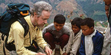 Tony meeting with boys helped by Save the Children near Likhu, Nepal.