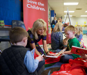 Save the Children Board Chair Dr. Jill Biden reads to 4-year-old preschool students Gus (right) and Cole (left)