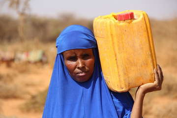 Hoodo, a mother of eight, collects water following a Save the Children water delivery in Gaatama village outside Burao in drought-affected Somaliland.
