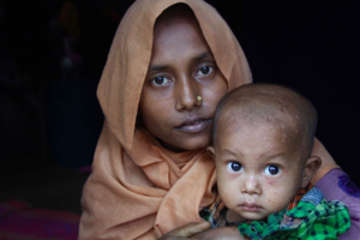 Majuma* fled her village in Northern Rakhine State with her husband and one and a half year old son after it was attacked. It took them five days to reach Bangladesh on foot, where they have found shelter in one of the makeshift settlements.