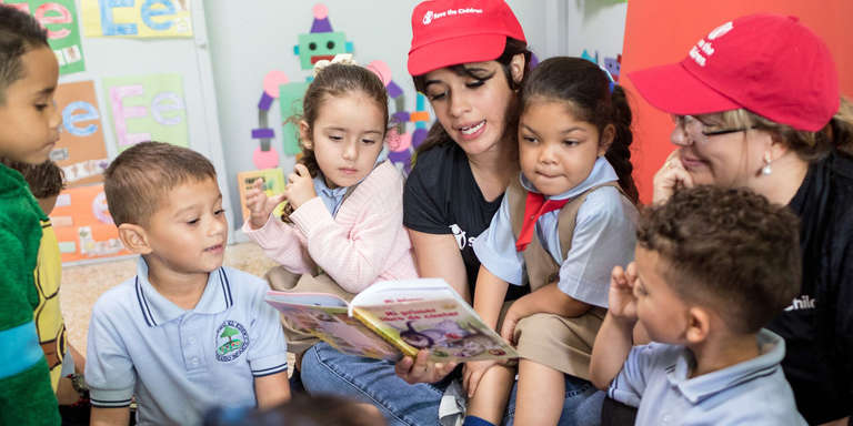 Camila Cabello with a group of children.