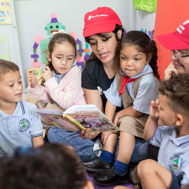 Singer-songwriter and Save the Children Ambassador Camila Cabello reads a book to the kids at a day care center in Puerto Rico. Photo Credit: Gabriel Gonzalez for Save the Children