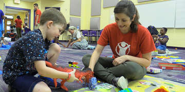 Children play with trained Save the Children staff and volunteers in a Child Friendly Space in an emergency shelter in the Florida Panhandle in the aftermath of Hurricane Michael. Save the Children's Child Friendly Spaces are safe, designated areas where children can play, socialize and begin to recover after a disaster, while allowing their parents to concentrate on addressing immediate and longer-term recovery needs. Photo credit: Nicolle Keogh / Save the Children.