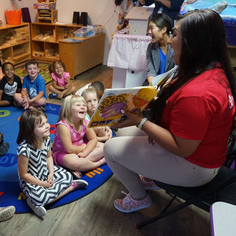 Save the Children staff member Kassi Starrine reads to children at a child care center supported by Save the Children in the aftermath of Hurricane Michael. Save the Children has helped more than 90 child care centers recover and reopen across the Florida Panhandle, so they can once again provide crucial early learning opportunities for the region's kids. Photo by Elissa Miolene for Save the Children.