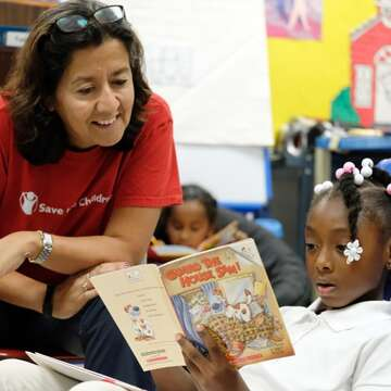 Save the Children's COO, Janti Soeripto, speaks with second grader Kaliyah about her book during guided independent reading on Thursday, September 26, 2019 in Ripley, Tenn.