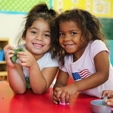 Dezirae, 4, and Harmony, 3, play with play-dough in their child care center in Texas. The center was heavily affected by Hurricane Harvey in August 2017, sustaining structural and interior damage and loss of critical classroom materials and equipment. In the aftermath of the catastrophic storm, funds, books and toys from Save the Children have helped restore and improve the child care center, and the children's day-to-day experiences. Save the Children also replaced the center's restroom and the counters in the kitchen. Photo by Ellery Lamm for Save the Children.