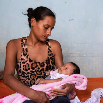 Ana, 26, moved from Venezuela to Colombia in 2019 during her high-risk pregnancy, and received pre- and post-natal care from Save the Children's health clinic. Credit: Sacha Myers/Save the Children.