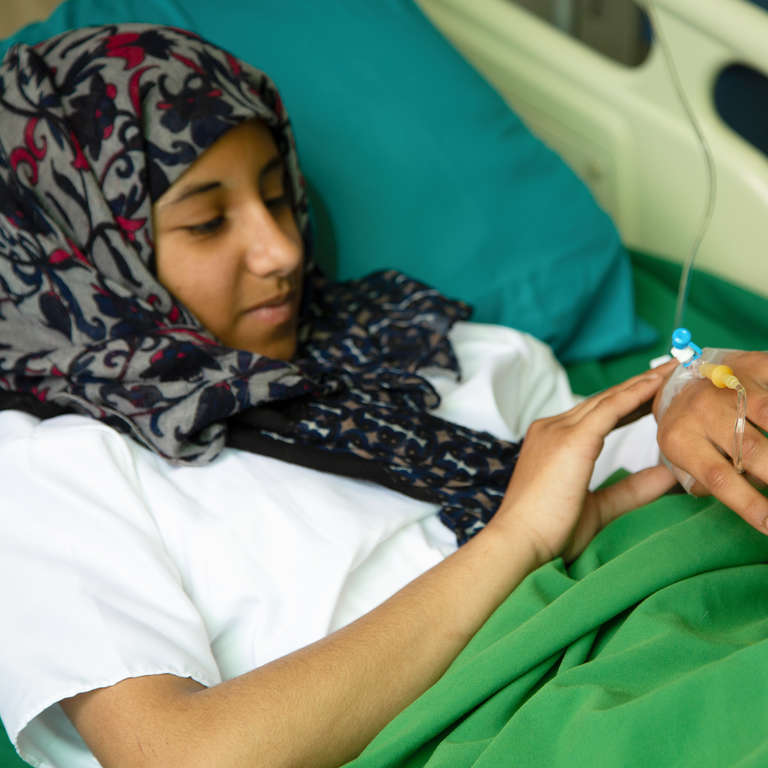 Doaa*, 13 receives treatment following a blast incident that took place at Al Raee school in Sana'a, Yemen which resulted in the death of eleven schoolgirls. Photo credit: Save the Children