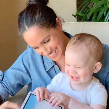 Duchess Meghan reads to baby Archie on his birthday.