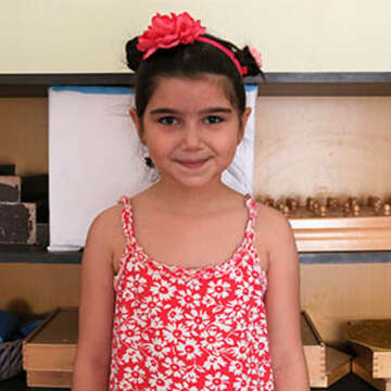 An 8-year old girl in Save the Children's child sponsorship program is pictured. The girls is a refugee from Syria and now lives in Egypt where an estimated 193,000 asylum seekers and refugees are now located. Photo credit: Save the Children.