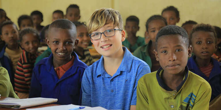 Sacha visiting Ethiopia through Save the Children's sponsorship program.
