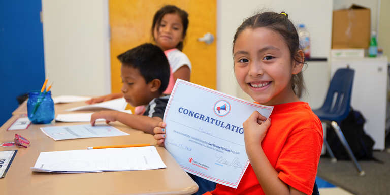 Maribel holds up a certificate of completion after participating in a Save the Children Prep Rally at her summer camp in Florida. Photo credit: Ellery Lamm, 2018.