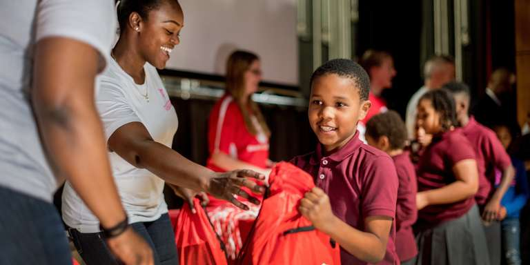 A boy receives a backpack at a prep rally to support Get Ready. Get Safe. Photo credit: Save the Children 2017.