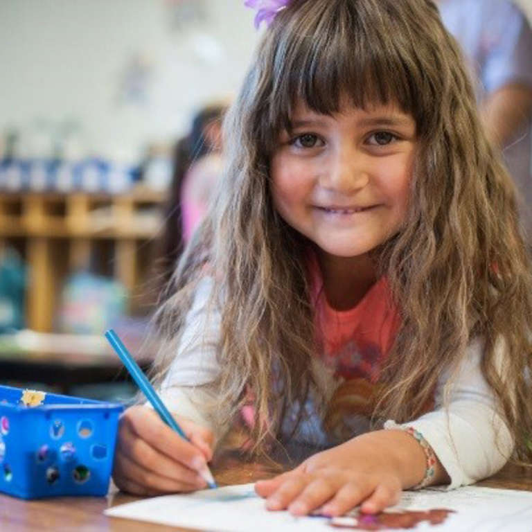 Five-year-old Madison colors with colored pencils in her preschool classroom. She attends Save the Children's Early Steps to School Success literacy program offered at her school in Colorado. Photo credit: Susan Warner / Save the Children, April 2016.