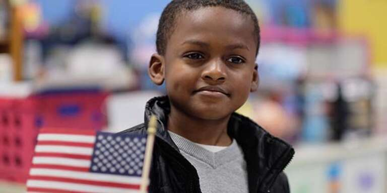 A young boy looks past the camera.