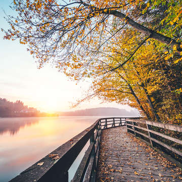 The sun rises along a river and pedestrian boardwalk. Photo credit: iStock Photography 2018.