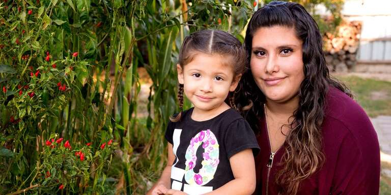 Analia, 3, with her mom during a home visit as part of Save the Children's signature Early Steps to School Success program in Central Valley California.