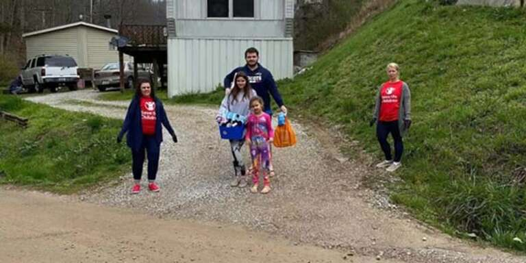 While practicing compassionate social distancing, Save the Children staff provide food to a family in rural Kentucky as the coronavirus pandemic continues to impact families across America.