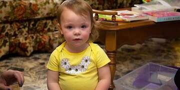 An 18-month old girl stares at the camera during an Early Steps home visit in Kentucky