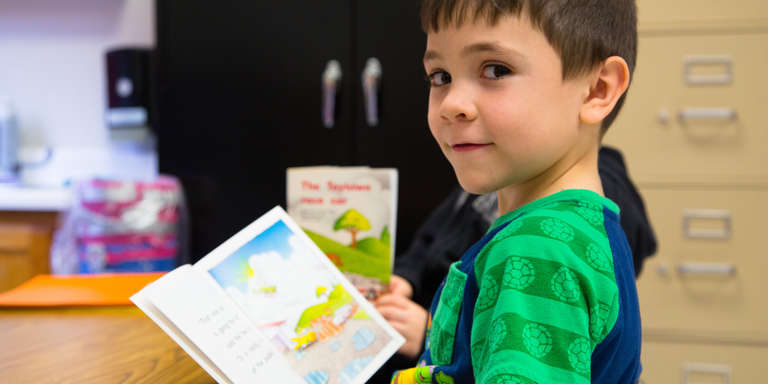 Brantley, 6, pauses while reading a book in his Kentucky classroom. Brantley is part of Save the Children's emergent reader literacy program which provides training, tools and support schools need to accelerate reading growth for struggling readers. Photo credit: Ellery Lamm / Save the Children 2018.