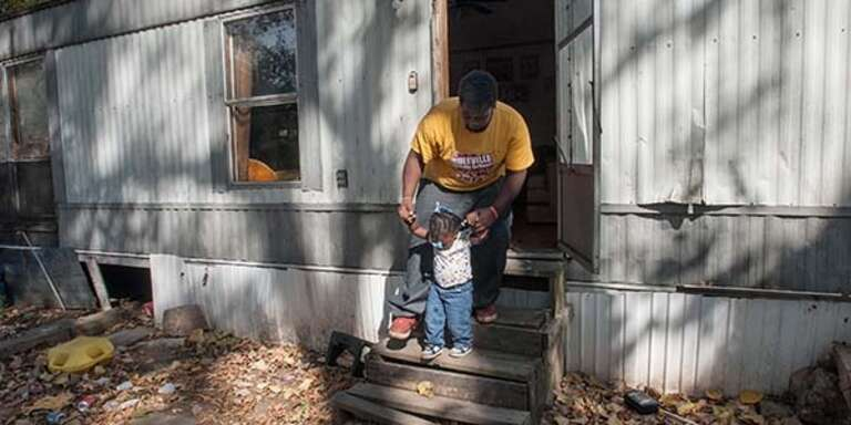 Denzel, 21, and his daughter 20-month-old Akeri participate in Save the Children's early childhood development program in Mississippi's Delta region.