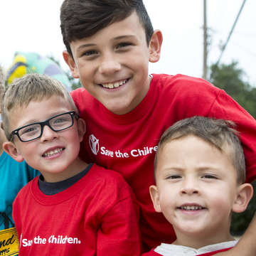 Three children pose for a picture at a learning center in Oklahoma. Photo credit: Save the Children 2017.