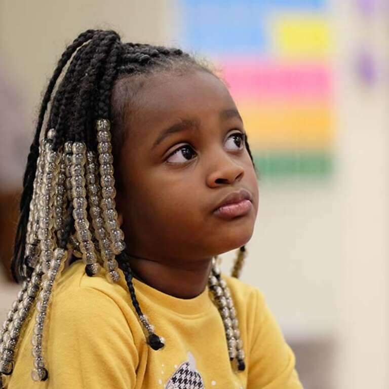 A 5-year old girl who is enrolled in Save the Children's Emergent Reader program at her school in Tennessee sits pensively in her classroom. Photo credit: Shawn Millsaps / Save the Children 2019.