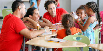Save the Children staff members interact with children at a child-friendly space in Canovanas, Puerto Rico. Playing helps them recover from the trauma they experienced from Hurricane Maria. Photo credit: Save the Children, September 2017.